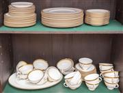 Sale 8908H - Lot 45 - A large quantity of Royal Doulton Royal Gold Pattern dinnerware, comprising 12 dinner and 12 entree plates, 11 bread plates, 13 soup...