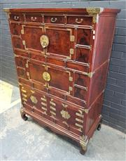 Sale 9031 - Lot 1063 - 18th Century (late Joseon period) Korean Elm or Zelkova Cabinet, embellished with brass mounts, having four short drawers across the...