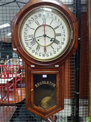 Sale 8598 - Lot 1031 - Late 19th/ Early 20th Century Ansonia Calendar Wall Clock, Regulator with red sweeping date hand