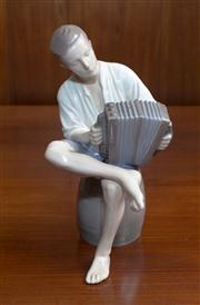 Sale 8313A - Lot 54 - A Royal Copenhagen (B&G) figure of an accordion player seated on a barrel, model number 1661, height 23cm