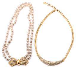 Sale 9149 - Lot 317 - TWO CHRISTIAN DIOR NECKLACES; one a double strand of faux pearls with crystal spacers to gold tone bow form clasp set with further c...