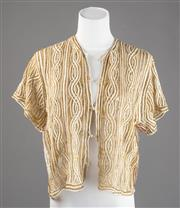 Sale 8499A - Lot 35 - An off-white and bronze handmade vintage short-sleeved blouse with spiral style pattern, c.1920s-1930s. Size: M to L.