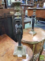 Sale 8539 - Lot 1002 - Pair of Brass Reproduction Candlesticks, in the Empire style, with patinated caryatids, H 31cm