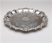 Sale 8716A - Lot 73 - A vintage English silverplate circular tray C: Mid 1900s, the elaborate centre of scrolls and folliates, framed by a wide floral an...