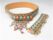 Sale 8499A - Lot 39 - A vintage 1960s beaded & sequined belt in coral, turquoise, gold & brown colours together with a pair of matching cuffs bracelets.