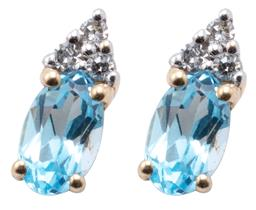 Sale 8982 - Lot 355 - A PAIR OF 14CT GOLD TOPAZ AND DIAMOND STUD EARRINGS; each a blue oval topaz adjacent to 3 single cut diamonds, length 8mm, wt. 0.83g.