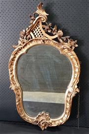 Sale 9031 - Lot 1093 - Rococo Style Gilt Mirror, with shell & rocaille below, surmounted by a crest with floral festoon & lattice panel (h:100 x w:57cm)