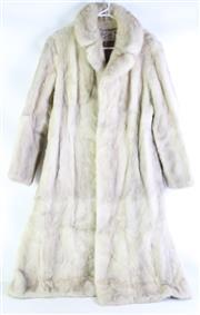 Sale 8985 - Lot 43 - A Cornelius studio design Sydney knee length fur coat (size small)