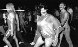 Sale 9082A - Lot 5045 - Sydney Gay and Lesbian Mardi Gras Parade, Oxford Street (1988), 23.5 x 15 cm, silver gelatin, Photographer: unknown