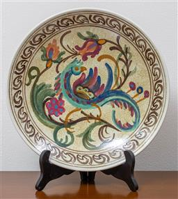 Sale 9140H - Lot 19 - A Greek hand painted ceramic wall plate with bird motif, Diameter 25cm