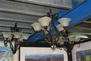 Sale 8509 - Lot 2359 - Set of Three Metal Chandeliers with Glass Shades