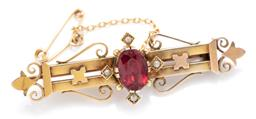 Sale 9169 - Lot 347 - AN ANTIQUE 9CT GOLD STONE SET BROOCH; set with an oval cut garnet top doublet and 4 faux pearls to fleur de lis ends with safety cha...