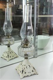 Sale 8340 - Lot 31 - Millers Kerosene Lamp on a Cast Iron Base