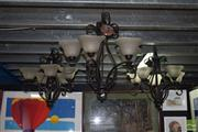 Sale 8509 - Lot 2360 - Set of Three Metal Chandeliers with Glass Shades