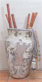 Sale 8550H - Lot 2 - A terracotta and painted antique olive jar with lug handles containing bamboo sticks and tie backs, H 80cm