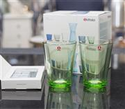Sale 8709 - Lot 1084 - A set of four green Iittala glass tumblers together with a set of whiskey stones