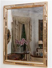 Sale 8435A - Lot 3 - A gilt cushioned framed mirror, 138 x 110cm, provenance Laura Kincade