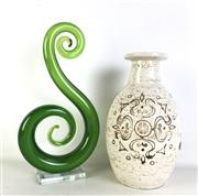 Sale 8963 - Lot 62 - Erica pottery vase (H20cm) together with a green  art glass koru (H25cm)