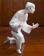 Sale 8313A - Lot 65 - A Lladro figure of a harlequin, marked to base, height 26cm
