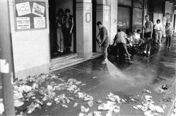Sale 8912A - Lot 5007 - Clean up after Sydney Gay and Lesbian Mardi Gras Parade (1994) 25 x 20 cm, silver gelatin, Photographer: unknown
