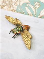 Sale 8500A - Lot 16 - A brass enameled cicada trinket with citrine, amber & emerald green Swarovski crystals - Measurements: 12cm long x 21cm wide  (wing...