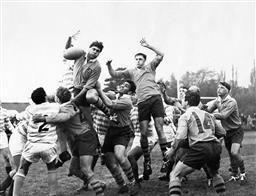 Sale 8754A - Lot 37 - Australia vs Cambridge University, Cambridge University, England, 11 September 1966 - Australian player C.P. Crittle leaps high in t...