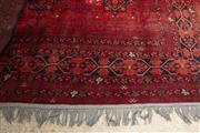Sale 8891H - Lot 48 - A Persian carpet of garden design on red ground, 306cm x 198cm