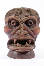 Sale 9015 - Lot 26 - A Carved Timber Deity Head H: 31cm