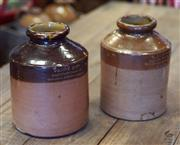 Sale 8320 - Lot 617 - 2 near matching Doulton Lambeth tobacco jars made for Taddys circa 1860s