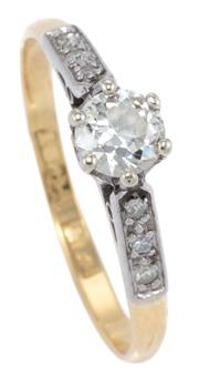 Sale 8982 - Lot 376 - A VINTAGE 18CT GOLD DIAMOND RING; centring an Old European cut diamond of approx. 0.33ct between upswept shoulders set with 6 single...