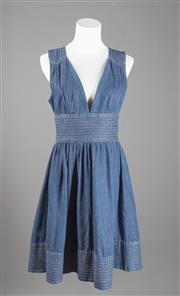 Sale 8499A - Lot 51 - A Zimmerman waisted pleated blue denim lowcut dress. Size: 2.