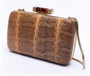 Sale 8921 - Lot 26 - A BALLY SNAKESKIN CLUTCH BAG; hard case python skin bag with gold tone hardware, detachable snake link chain handle and faux tortois...