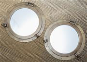 Sale 8709 - Lot 1085 - A pair of brass porthole mirrors, Diameter 53cm