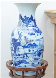 Sale 8908H - Lot 69 - A Chinese blue and white baluster vase with red oxide highlights, decorated with pagodas in a rocky landscape. Height 46cm