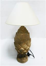 Sale 8312A - Lot 52 - A cast stone pineapple finial table lamp, height to brass lamp holder 64 cm (with cream shade)