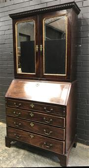 Sale 9048 - Lot 1071 - George III Mahogany Associated Bureau Cabinet, the top with two mirror panel doors, having gilt moulded edge & candle slide, above a...