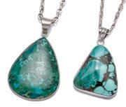 Sale 9012 - Lot 331 - TWO LARGE SIVER STONE SET PENDANT NECKLACES; freeform turquoise and malachite in matrix, other drop shape eliat stone, lengths 5-6cm...