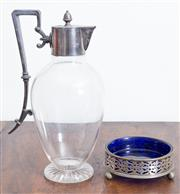 Sale 8440A - Lot 37 - A silver plated and glass claret jug together with a silver plate bottle coaster with blue glass liner, taller H 28cm