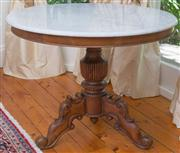 Sale 8435A - Lot 11 - An Indian turned and carved hard wood centre table with white marble top, D 100 x H 79cm
