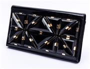 Sale 8921 - Lot 32 - A GUCCI BLACK PATENT LEATHER CLUTCH; with applied black triangular panels in gold tone fittings, black suede and satin interior with...