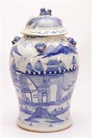 Sale 9015C - Lot 768 - Blue and white lidded Chinese jar with lion finial and handles, body featuring village scenes (total height 46cm, crackline to lid)