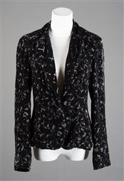 Sale 8499A - Lot 56 - A vintage black velvet tailored jacket with blue/gray pattern, lined. Size: S.