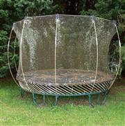 Sale 8677A - Lot 31 - Two freestanding trampolines, one with surround.