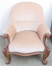 Sale 8440A - Lot 39 - A camel velvet upholstered spoon back easy chair with carved and scrolled frame