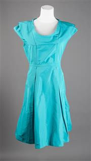 Sale 8499A - Lot 57 - A Miu Miu (Italian made) bright blue waisted knee-length dress with pleats. Size 42.