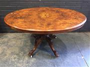 Sale 9031 - Lot 1056 - Victorian Inlaid Figured Walnut Loo Table, the oval top with foliate motifs, on a turned pedestal with outswept feet (H: 71 x W: 131...