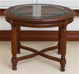 Sale 9155H - Lot 97 - A oak carved occasional table, with bevelled glass top raised on cross base and column supports Height 53cm x Width 66cm x Depth 57cm
