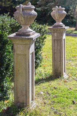Sale 9190H - Lot 1 - Pair of concrete plinths supporting twin handled vases, plinth Height 92cm, vase Width 35cm