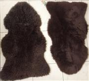 Sale 8338A - Lot 77 - A pair of brown sheepskin rugs, by Ugg Boots of Australia, made in Australia