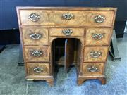 Sale 9048 - Lot 1022 - George I Walnut Desk, with a long & short drawers above a central knee-hole cupboard, flanked by three drawer either side, the sides...